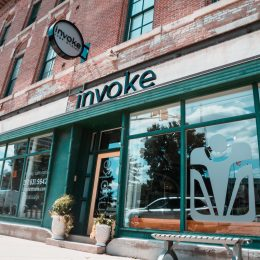 Invoke Studio is easily recognizable with their photogenic glass facade and branding well displayed for anyone driving by on Fort Wayne Ave.