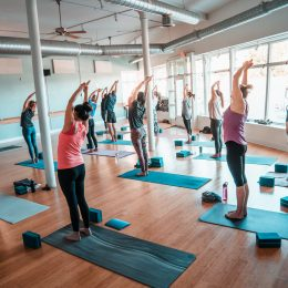 Yoga salutations in the large main studio room.