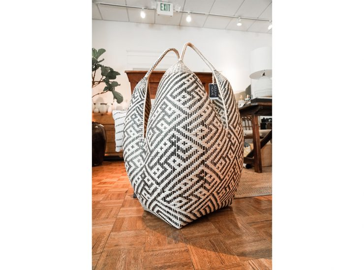 An intricately weaved basket- perfect to throw all your cozy blankets in.