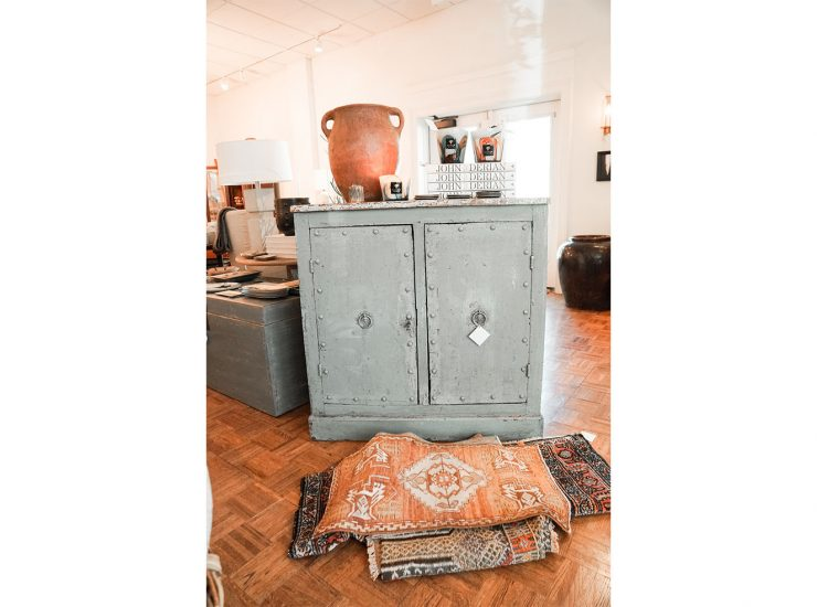 A statement piece- this storage cabinet is perfect to hide all your cozy blankets and pillows. Add a unique touch with one of Willa Gray's beautifully designed rugs.