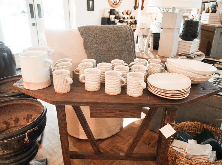 Need a new dining set? Consider these cream plates, mugs, pitchers, and serving bowls.
