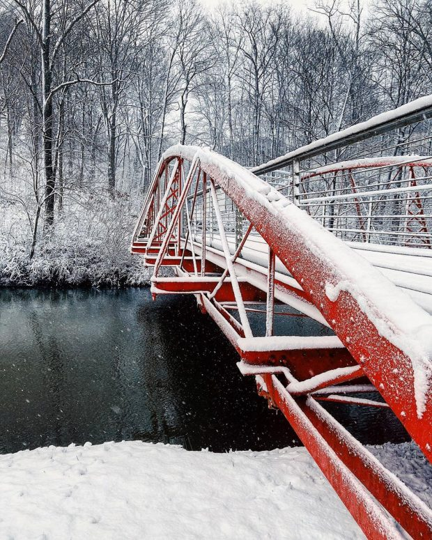 Bridge at Newfields Indianapolis Museu of Art covered in snow